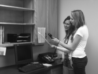 Leadership students Mandy Matthews and Rachel Roskelly utilize the new intercom system during second period.