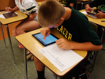 CJ Kannady, freshman, uses one o fthe iPads that the Placer science department provided for the first time.