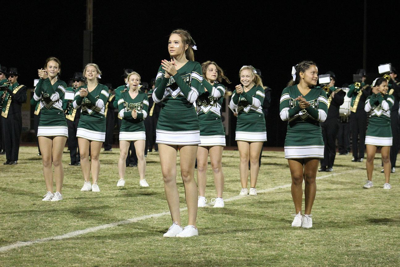 This year's cheerleading squad performs at the Homecoming game.  Some students wonder why they limit their appearances to just football and basketball.