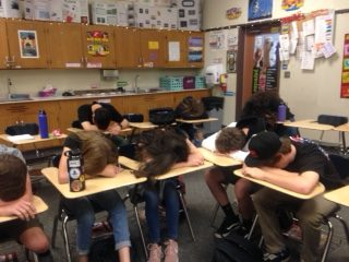Students jokingly show morning fatigue.